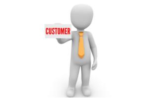"cartoon figure holding sign saying ""customer"""